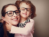 Loving happy mother and smiling daughter hugging. Vintage closeup portrait — Stock Photo