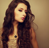 Beautiful bright makeup woman with long curly hair looking sexy — Stock Photo