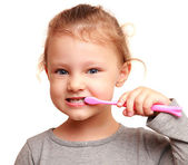 Smiling girl child brushing teeth. Isolated closeup portrait — Stock Photo