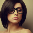 Beautiful woman with black hair in fashion glasses. Closeup vintage portrait — Stock Photo #49228479