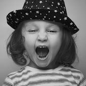 Shouting angry kid girl face. Closeup. Black and white portrait — Stock Photo