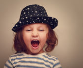 Angry shouting kid girl with open mouth. Closeup vintage portrait — Stock Photo