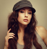 Vintage closeup portrait of sexy woman in hat looking flirting — Stock Photo