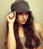 Sexy female model in cap looking sexy. Vintage portrait — Stock Photo