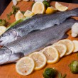 Trout in lemons — Stock Photo