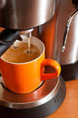 Coffee cup in the percolator — Stock Photo