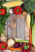 Vegetables on old boards as the background — Stock Photo