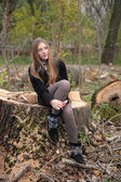 Felled trees and a girl. — Stock Photo