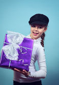 Little girl with a gift. — Stock Photo