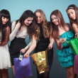 Group of cheerful girl with purchases. — Stock Photo #19639129