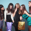 Group of cheerful girl with purchases. — Stock Photo #19639189