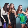 Stock Photo: Group of cheerful girl with purchases