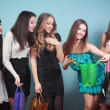 Group of cheerful girl with purchases — Stock Photo