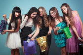 Group of cheerful girl with purchases. — Stock Photo