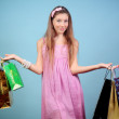 Foto Stock: Girl with purchases.