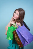 Happ girl with purchases. — Stock Photo