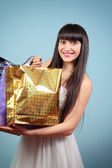 Happy girl with purchases. — Stock Photo