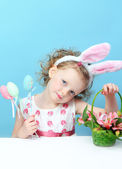 Little, fun girl with bunny ears — Stock Photo