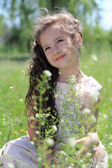 Girl on grass. — Stockfoto