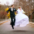 Bouncing newlyweds — Stock Photo #38296143