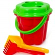 Play set with bucket, shovel and rake on white — Stock Photo