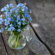 Forget-me-not flowers on wooden surface — Stok fotoğraf