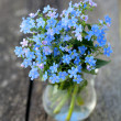 Forget-me-not flowers on wooden surface — Zdjęcie stockowe