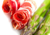 Asparagus and proschiuto meat — Stock Photo