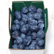 Stock Photo: Blueberries in box on wooden table