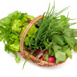 Stock Photo: Basket with herbs and vegetables
