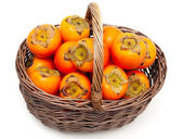 Persimmons in a basket — Stock Photo