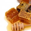 Honey comb and dipper — Stock Photo