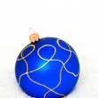 Blue Chritsmas Ball lying on snow — Stockfoto