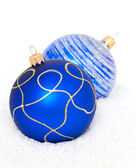 Blue Chritsmas Balls lying on snow — Foto Stock