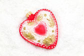 Christmas red heart lying on snow — Foto Stock