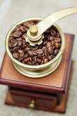 Coffee grinder on burlap — Stock Photo