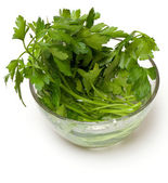 Bunch of parsley in a glass bowl — Stock Photo