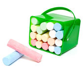 Chalks in a variety of colors arranged on a white background — Stock Photo