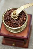Coffee grinder on burlap — Stock Photo