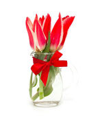 Red tulips in glass vase — Stock Photo