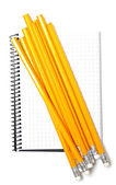 Notebook and bunch of pencils isolated on white background — Photo