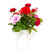 Different roses in vase — Stock Photo