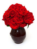 Beautiful red roses in clay vase — Stockfoto