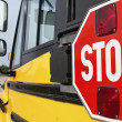Stop sign on yellow school bus — Stok fotoğraf #5783380
