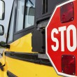 Stop sign on yellow school bus — Stock Photo #5783380