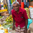 Seller on local market in Sri Lanka - April 2, 2014 — Stock Photo #44526435