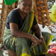 Seller on local market in Sri Lanka - April 2, 2014 — Stock Photo #44526545