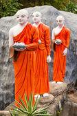 Buddhist monk statues going to Gold Buddha temple, Dambulla, Sri — Stock Photo