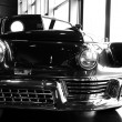 Classic car with three piece head light set in black and white — Stock Photo