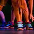 Feet, ankles and arms of a hip-hop performers in colorful sneakers — Stock Photo